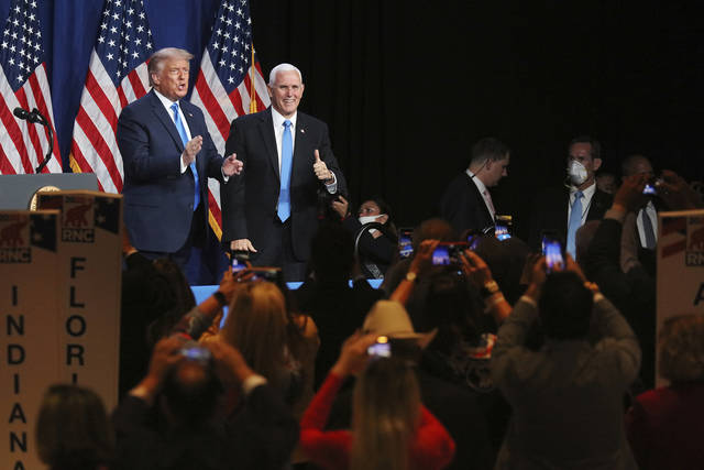 President Donald Trump and Vice President Mike Pence give a thumbs up after speaking during the first day of the Republican National Convention Monday, Aug. 24, 2020, in Charlotte, N.C. (Travis Dove/The New York Times via AP, Pool)