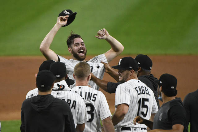 Chicago White Sox starting pitcher Lucas Giolito, facing camera, and teammates celebrate his no-hitter in a baseball game against the Pittsburgh Pirates, Tuesday, Aug. 25, 2020, in Chicago. (AP Photo/Matt Marton)