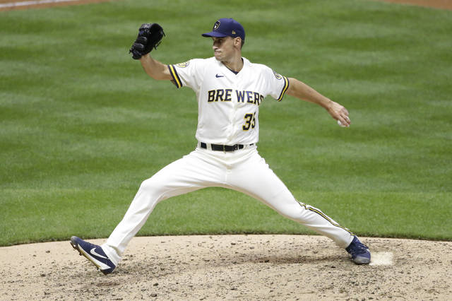 Milwaukee Brewers' Brent Suter pitches during the seventh inning of a baseball game against the Cincinnati Reds Tuesday, Aug. 25, 2020, in Milwaukee. (AP Photo/Aaron Gash)