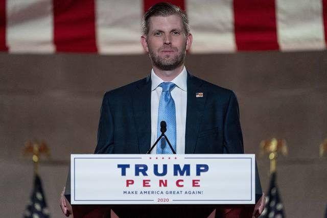 Eric Trump, the son of President Donald Trump, waits to tape his speech for the second day of the Republican National Convention from the Andrew W. Mellon Auditorium in Washington, Tuesday, Aug. 25, 2020. (AP Photo/Andrew Harnik)