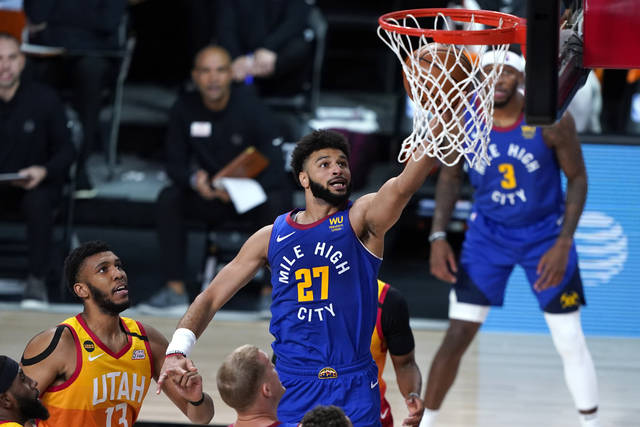 Denver Nuggets' Jamal Murray (27) goes up for a shot against the Utah Jazz during the first half of an NBA basketball first round playoff game Sunday, Aug. 30, 2020, in Lake Buena Vista, Fla. (AP Photo/Ashley Landis)