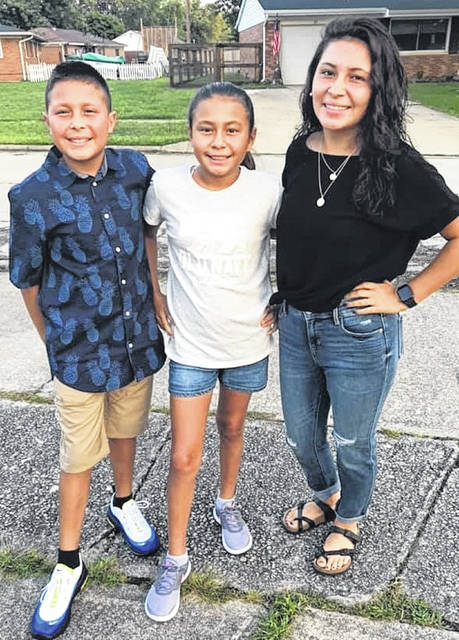Seventh-grader Aidan, sixth-grader Alexa and 10th-grader Adriana.