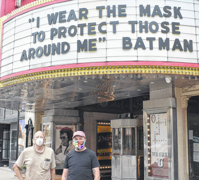 Dan Stewart, left, and Andrew Connarroe stand beneath Murphy Theatre's marquee.