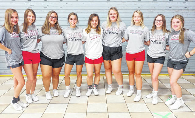 The East Clinton High School varsity football cheerleaders, from left to right, junior Haillie Byrum, junior Kloe Creek, senior Brianna Rider, senior Alexis Rolfe, senior Maura Elzey, senior Haven Bosier, junior Skyla Taylor, junior Chelsey Zurface and freshman Emma Riddle.