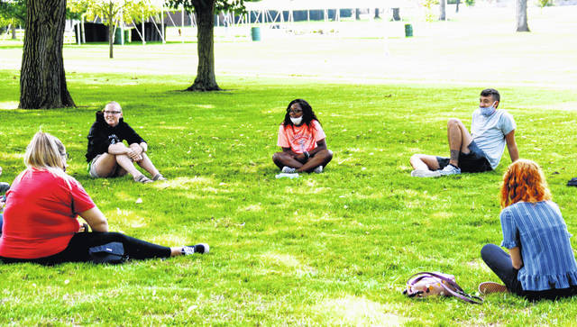 Members of the entering class are divided into 15-person cohorts that stick together throughout the three-day New Student Orientation program. The relatively small groups are able to practice physical distancing, as evidenced by this group meeting Friday morning near the Simon Goodman Memorial Carillon.
