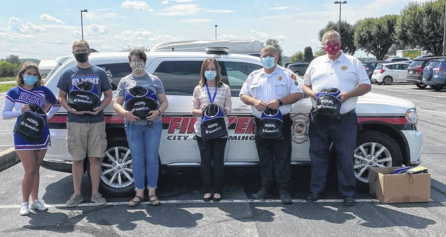 From left are: Jenna Norman and Logan Florea, LCYC Class of 2020; Meagan Morabito, advisor; Misty Dixon, Clinton County Emergency Management Agency; Andy Mason, Wilmington Fire Chief; Bob Wysong, Clinton-Warren Joint Fire Rescue District. Not present, Ethan Amstutz and Leah Burton, LCYC Class of 2020.