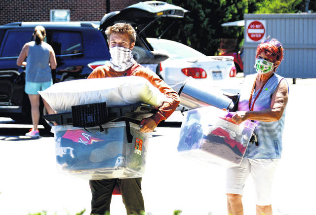 New students began moving into Wilmington College Wednesday afternoon and will continue Thursday in time for their New Student Orientation program. Upperclassmen will return to campus this weekend with fall semester classes starting Monday. Parker Ross of Scott Depot, West Virginia, and his grandmother, Darlene Franklin, move his belongings into Austin-Pickett Hall.