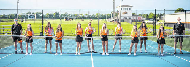 The Wilmington High School tennis team, from left to right, junior varsity coach Keith Gilbert, Rory Housh, Chandni Sharma, Emilee Pham, Jenna Taylor, Ella Zeigler, Claire Burns, Josie Heys, Emma Lewis, Avni Patel, Gracie Conger, varsity coach Doug Cooper.