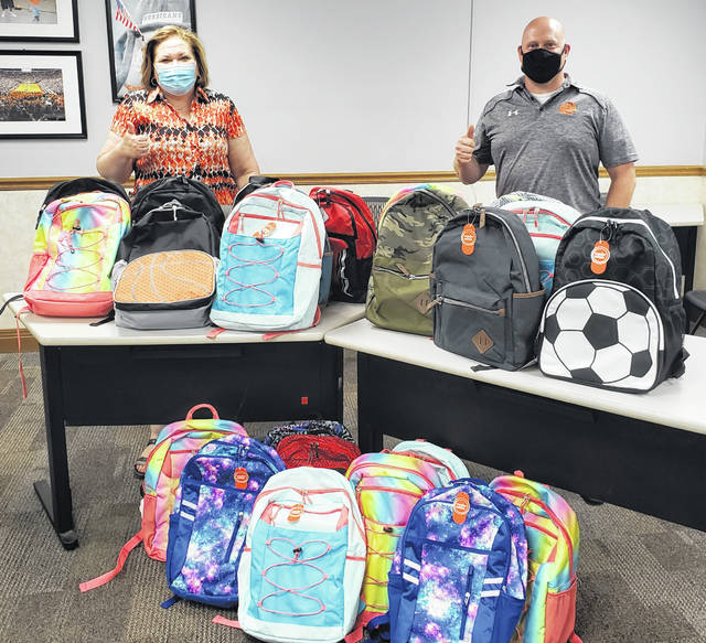 Wilmington City Schools received a donation of backpacks filled with school supplies from Wilmington Auto Center. The donations will go a long way toward helping kids in this community have a successful year of school. During the Wilmington Auto Center donation are, from left, Rachel Adkins of WAC and Curt Bone, WCS Director of Operations. WCS expressed their deep appreciation for the donations from both groups.