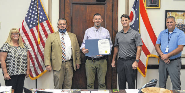 """On Wednesday, Clinton County commissioners commended and congratulated Adam Green for receiving the 2020 George W. Farmer Line Officer of the Year Award. Green is a senior probation officer for the Clinton County Juvenile Court. The commissioners' proclamation states Green """"has performed his assigned duties in an outstanding manner and made significant contributions to the local community."""" The George W. Farmer Line Officer of the Year Award is a practitioner award for field officers actively involved in supervision, and the recipient is chosen by the Ohio Chief Probation Officers Association. The state association is a non-profit organization that works to maximize the impact of probation through training, networking and advocacy. From left are Clinton County Commissioner Brenda Woods, Clinton County Juvenile Court Judge Chad Carey, honoree Adam Green, and Clinton County Commissioners Kerry Steed and Mike McCarty."""