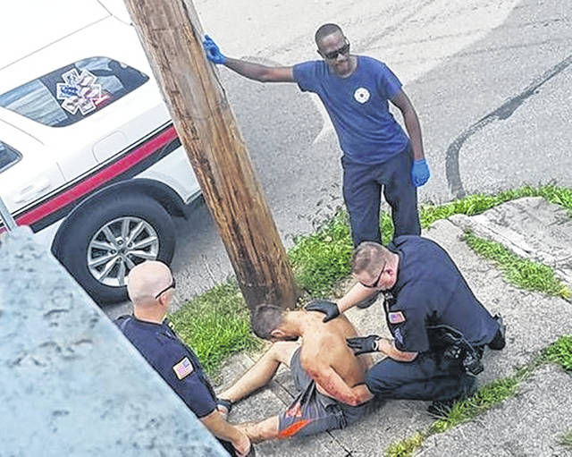 The suspect is placed in handcuffs by Wilmington Police Sgt. Ron Fithen after a foot chase and pursuit by WPD officers and the Wilmington Fire Department that ended with the apprehension at North Walnut and Columbus streets late Wednesday afternoon.