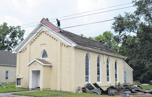 On Monday morning a work crew was preparing the way to re-roof the original part of the Bible Missionary Baptist Church on Grant Street in Wilmington. The church building was constructed in 1874, according to an inscription on the exterior wall above the entrance.