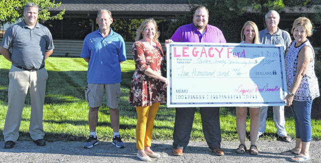 Legacy Fund Committee members join Clinton County Community Action staffers to publicize the not-for-profit organization's upcoming Head Start outdoor classroom, funded through a Legacy Fund grant. From left are Mike McCarty, Joe Hete, Michelle Morrison, Head Start Director Zach Foster, his colleague Clarissa Walls-Parker, Tony Long, and Janet Dixon.
