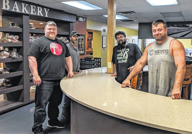 From left, Sugartree Ministries Director Lee Sandlin, Mike Hutchins, Jason Hollingsworth and Kaleb Holcomb stand in the kitchen at Sugartree Ministries (Your Father's Kitchen).