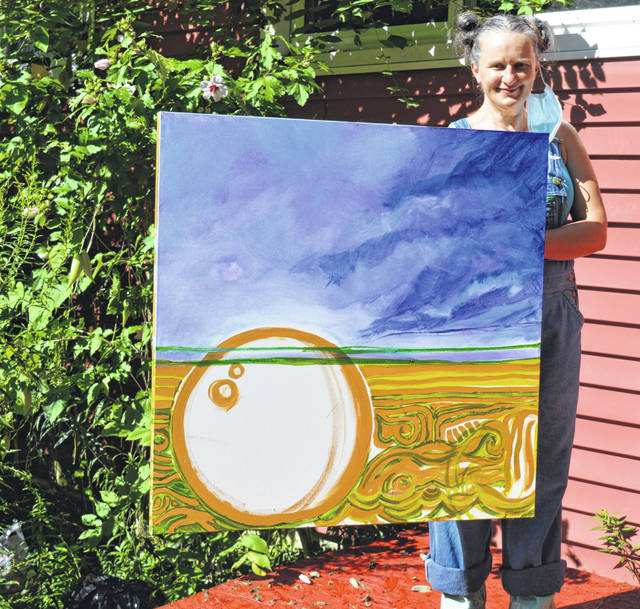 "A virtual gallery show is set for 7 p.m. Friday, Aug. 21 with oil paintings and a wood sculpture by Wilmington artist Elena Raye Clair. The show is called ""Nature"". In the 3-foot-by three-foot painting Clair is holding, the bubbles represent the sunrise and sunset. Notice the foreboding sky. Part of what she wants her paintings in the show to say is: ""While the storm is happening, we creatures can just hunker down and band together."" Clair said she is experimenting with driftwood and partly burnt wood, and she's been practicing making her own charcoal. Figure drawings by artists often are in charcoal. Viewers can follow the Instagram live feed on Thorngren Studio Arts page and Facebook with the same name. In-person attendance for the show opening at Thorngren Studio Arts in downtown Wilmington is limited to six guests at a time, masks required."