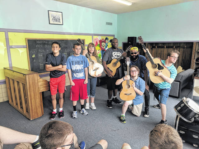 CCYC Music Instructor George Byrd, standing second from right, with students in summer 2019.