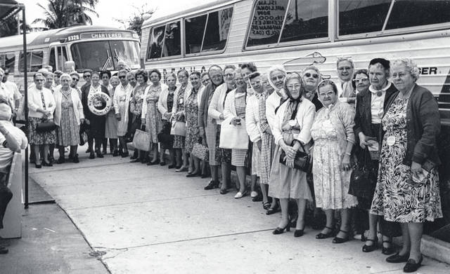 """A """"1970 senior citizens outing. Pictured: Mary McMullen, Mable Ryerson (?), Iva Hale, Belva Redfern, Helen Conner, Bess Hiatt, Mrs. Cherry, Lenora Perry, Mrs. Campbell, Elta Hodson, Mrs. Greathouse, Hazel Penn, Ruth Bloom, Minnie Mathews, Sara Fife, Mrs. McKay, Vada McDermott, Bertha Curtis, Edith House, Marie Barlow, Bessie Bloom, Maude Brewer, Mary Oglesbee, Chrystelle Carver, Nora Johnson, Helen Sewell, Iva Lou Custis, Maude Anderson, Blanche Brown, Jenny Hodson, Margurite Gumley, Mr. & Mrs. Clarke Negley, and Mr. and Mrs. Bill Sweeney."""" Can you tell us more? Share it at info@wnewsj.com. The photo is courtesy of the Clinton County Historical Society. Like this image? Reproduction copies of this photo are available by calling the History Center. For more info, visit www.clintoncountyhistory.org; follow them on Facebook @ClintonCountyHistory; or call 937-382-4684."""