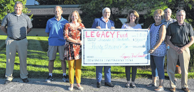 Legacy Fund Committee members join members of the Friends of Clarksville group to celebrate the not-for-profit organization's community park project, supported by a recent Legacy Fund $30,000 grant. From left are Mike McCarty, Joe Hete, Michelle Morrison, Carol Jean Carter and Kathy Rager both with the Friends group, Janet Dixon, Tony Long, and Wade Hall with the Friends of Clarksville.