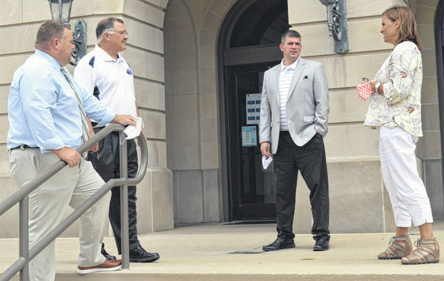 <strong>NOBODY ENVIES THEM THEIR JOB</strong>: From left outside the courthouse this week are East Clinton Supt. Eric Magee, Blanchester Schools Supt. Dean Lynch, Clinton-Massie Supt. Matt Baker, and Wilmington City Schools Supt. Mindy McCarty-Stewart.