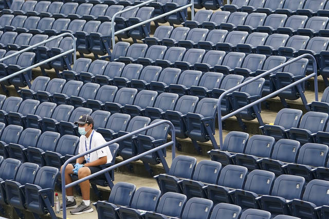 A member of the USTA crew watches a match during the first round of the US Open tennis championships, Monday, Aug. 31, 2020, in New York. (AP Photo/Frank Franklin II)