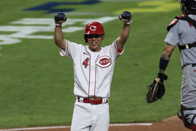 Cincinnati Reds' Shogo Akiyama reacts to scoring the game winning run on a walk-off RBI single by Joey Votto in the ninth inning during a baseball game against the St. Louis Cardinals in Cincinnati, Wednesday, Sep. 2, 2020. (AP Photo/Aaron Doster)