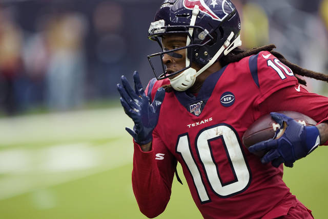 FILE - In this Dec. 8, 2019, file photo, Houston Texans wide receiver DeAndre Hopkins runs for a touchdown against the Denver Broncos after a catch during the second half of an NFL football game in Houston. Hopkins may be a perfect fit for the Cardinals. (AP Photo/David J. Phillip, File)