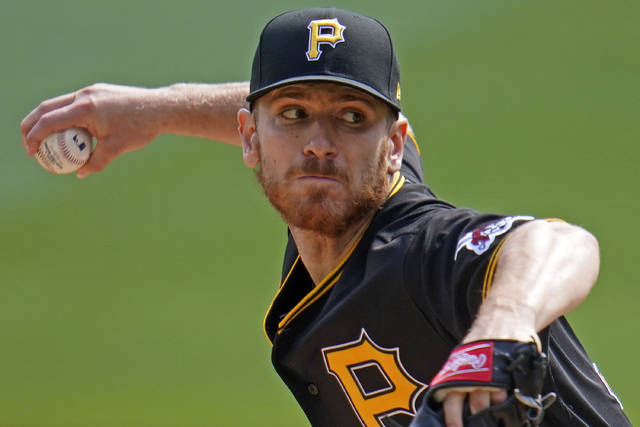 Pittsburgh Pirates starting pitcher Chad Kuhl delivers during the first inning of the team's baseball game against the Cincinnati Reds in Pittsburgh, Sunday, Sept. 6, 2020. (AP Photo/Gene J. Puskar)