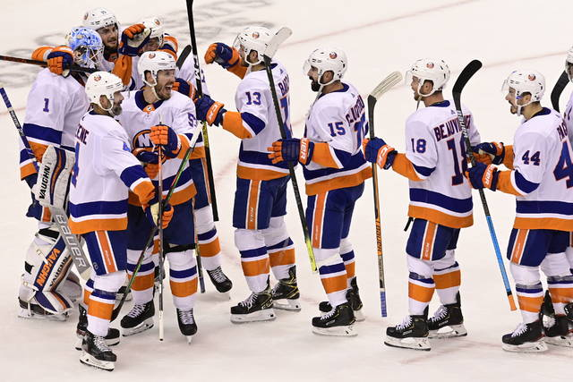New York Islanders celebrate defeating the Philadelphia Flyers after third-period NHL Stanley Cup Eastern Conference playoff hockey game action in Toronto, Saturday, Sept. 5, 2020. (Frank Gunn/The Canadian Press via AP)