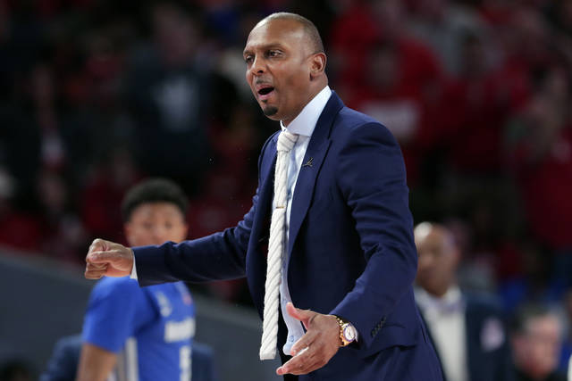 "FILE - Memphis head coach Penny Hardaway questions a foul call during the second half of an NCAA college basketball game against Houston, Sunday, March 8, 2020, in Houston. As the NCAA gets set announce its plans for the 2020-21 college basketball season, there are clear precedents and blueprints in place should it decide to go the bubble route. ""Maybe do it for maybe a week or two at a time, playing a certain amount of games and getting retested after you come back or something like that,"" Memphis coach Penny Hardaway said. ""It's possible, it's not going to be easy.""(AP Photo/Michael Wyke, File)"