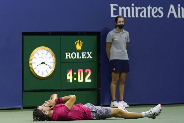 Dominic Thiem, of Austria, reacts after defeating Alexander Zverev, of Germany, in the men's singles final of the US Open tennis championships, Sunday, Sept. 13, 2020, in New York. (AP Photo/Frank Franklin II)