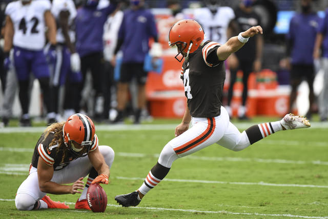 Cleveland Browns place kicker Austin Seibert (4) attempts an extra point in the first half during an NFL football game against the Baltimore Ravens, Sunday, Sept. 13, 2020, in Baltimore. The Browns are replacing kicker Austin Seibert after he missed an extra point and field goal in Sunday's opener, a person familiar with the decision told the Associated Press. Seibert, who clanged his extra point off the left upright and pushed a 41-yard field-goal try to the right, will be replaced by Cody Parkey, said the person who spoke on condition of anonymity because the team has not made the move official. (AP Photo/Terrance Williams, File)