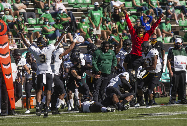 Appalachian State players celebrate an interception by safety E.J. Jackson during an NCAA college football game against Marshall Saturday, Sept. 19, 2020, in Huntington, W.Va. (Sholten Singer/The Herald-Dispatch via AP)
