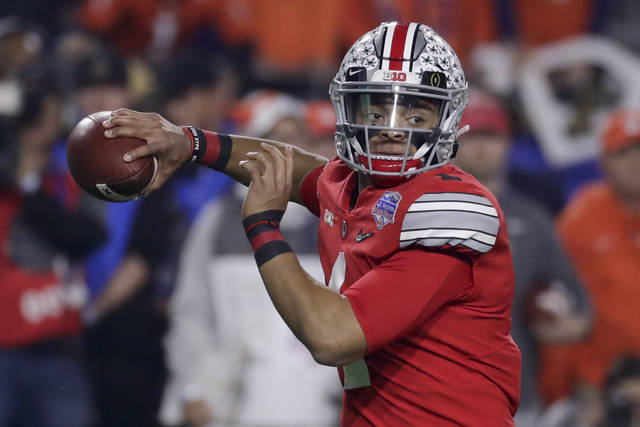 "FILE - In this Dec. 28, 2019, file photo, Ohio State quarterback Justin Fields throws a pass against Clemson during the first half of the Fiesta Bowl NCAA college football playoff semifinal in Glendale, Ariz. When Fields got together with some of his teammates last Saturday to watch college football on TV, the mood was dark. ""Distraught,"" Fields said. (AP Photo/Rick Scuteri, File)"