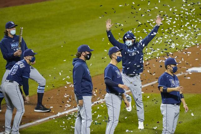 Tampa Bay Rays' Yoshitomo Tsutsugo, right, of Japan, celebrates with teammates after a baseball game against the New York Mets Wednesday, Sept. 23, 2020, in New York. The Rays won 8-5. (AP Photo/Frank Franklin II)