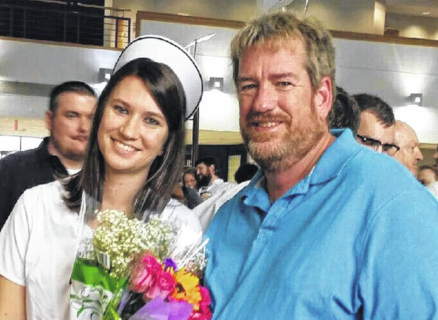 Megan Culbertson, left, with her father Mark Weaver, at her nursing school graduation in 2017.