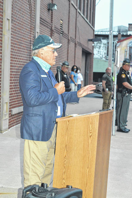 Wilmington Mayor John Stanforth, foreground, speaks Friday at the 9/11 Day of Remembrance.