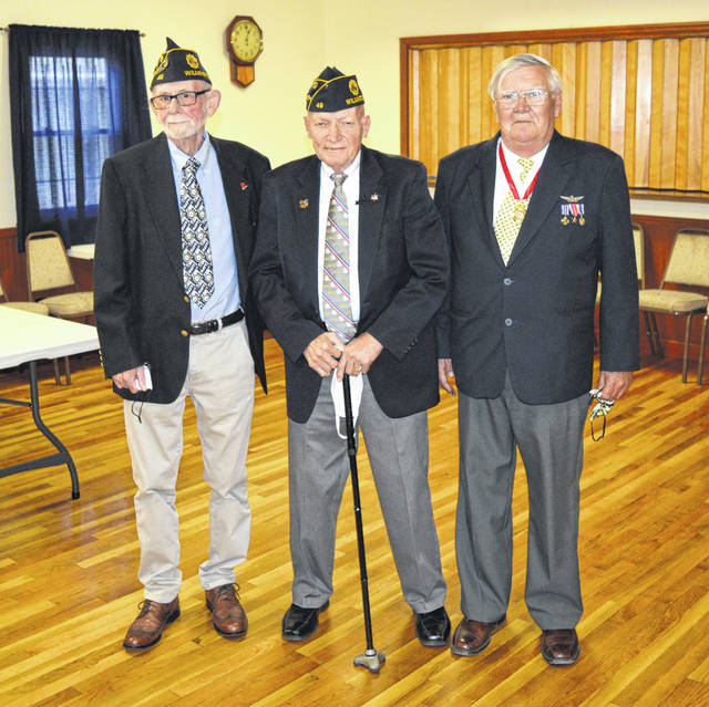 Veterans and longtime friends Jerry LeForge, left, and John Arvai, right, with Paul Butler at the ceremony.