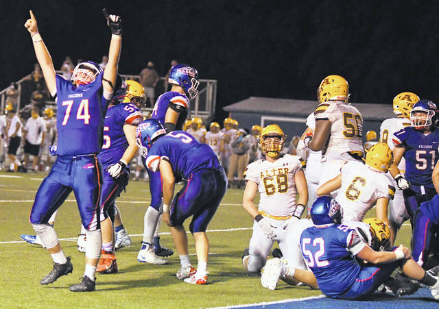 Clinton-Massie's Garrett Vance (74) celebrates during a play from Friday night's win over Kettering Alter, 42-32, at Frank Irelan Field.