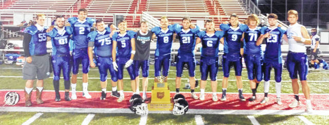 Blanchester seniors, with the King of the Road Trophy following last week's 41-27 win over Goshen, are, from left to right, Drew Williams, Noah Faulkner, Brayden Sipple, Hunter Rinear, Bryce Highlander, Brady Phillips, Trenton Czaika, Gage Huston, Colt Conover, Logan Heitzman, Shane Garrett, Blake Richard and Brody Rice.