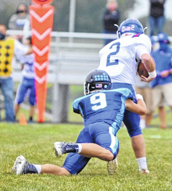 Blanchester's Logan Heitzmann (9) with a tackle during last week's game against Williamsburg.