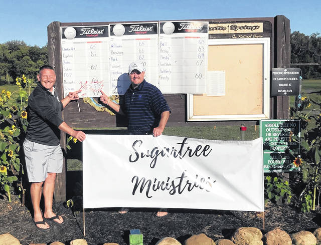 In the photo are John Schram and Joe Dixon, two of the four members of the Schram team that shot 58 and won the 11th annual Sugartree Ministries / Your Father's Kitchen / Joe's Java golf outing Sept. 18 at Majestic Springs Golf Course. The other two members of the championship team were Randall Davis and Brady Snyder.