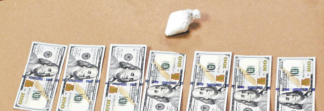 Police said that in March John Pike Jr. possessed these drugs and a large amount of cash.