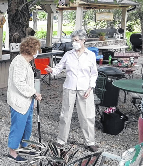 Wilmington Garden Club members, masked and socially distanced, met recently.