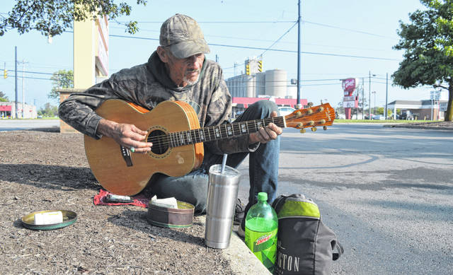 In one of his customary spots at a Wilmington shopping center, Dave plays a Bob Seeger song on a recent September Saturday.