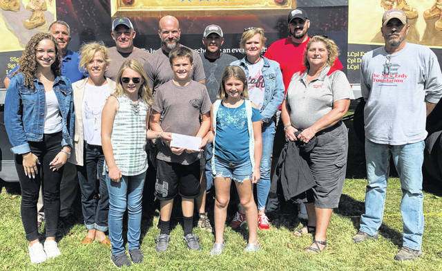 The Kids Care Clubs from the Sabina and New Vienna Elementary Schools presented a check for Honor Flight. The children raised $605.05. Among those pictured are veterans who were at Cherrybend Pheasant Farm in Clinton County for the weekend, Jack Powell and Jen Woodland as representatives of Honor Flight, Kendell and Reese Debold and Colt Jamisison, East Clinton School Nurse Lisa Stevens and Cheryl Roberts who is one of the advisors of the Kids Care Clubs at East Clinton Schools.