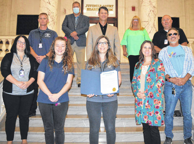 From left in the front are Amanda Gordley, Brittany Patterson, Jessica Harrington, Brenda Harris, and James Crafton; and from left in the back are Jeff Lemmons, County Commissioners Mike McCarty, Kerry Steed and Brenda Woods, and Chief Probation Officer Duane Weyand.