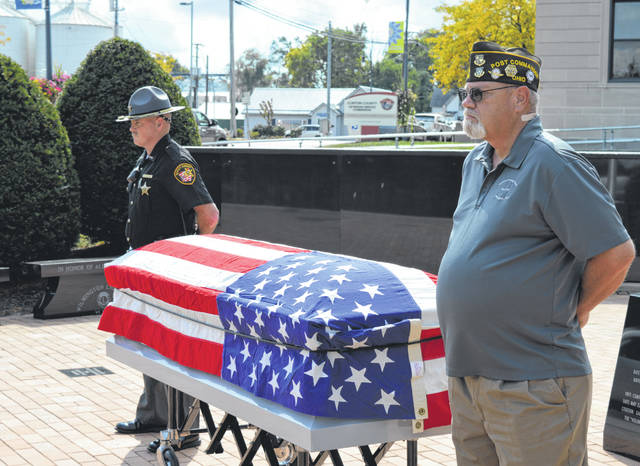 """For the second year, a veterans suicide prevention awareness event called """"Silent Watch"""" was held at the Clinton County Veterans Memorial from 9 a.m. to 5 p.m. Saturday. In the photo, from left, Clinton County Deputy Sheriff Brandon Wooton and local VFW Commander and Veterans Service Commissioner Richard James stand in solemn silence next to a flag-draped casket. The other people who stood watch Saturday are Jeff Rollins, Jennifer Woodland, Jack Rose, Valerie Rose, Paul Butler, Joni Fair, Tony Greene, Jim Alcorn, Kelly Hopkins, Tracy Hopkins, Jack Powell, Tim Bosher, Steve Jarrell, Greg LaPine, Renee LaPine, Jim Gumley, Mary McElwee, Peyton Reed, Travis Elenberger, Desriel Brewer, Terry Kerr, Charlie Lakatos, Richard Maples, Mike Kassinos, Mercedes Bowman, Mike Sutton, Dan Ellen, Ronnie Dunn, Enmanuel Gonzalez, Solomon Wallis, Ron Cravens, Nancy Stanforth, Tom Couch, Tim Smith, Ann Wilkinson, Randy Pinkerton, Mindy Pinkerton, Josh Jones, Pauline Taylor, Josh Sams, Dan Evers, Matt Swindler, Pat Black, Laymon Wilder, Keith Shrout, Jeanie Longstreth and Chrissy Smith."""