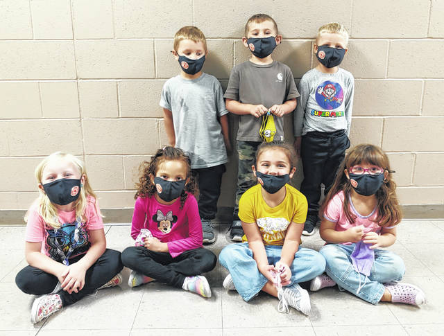 Wilmington preschoolers show their new masks.