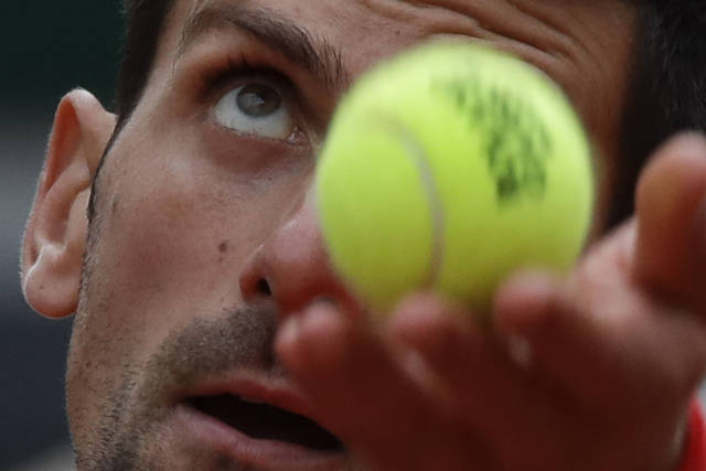 Serbia's Novak Djokovic serves against Lithuania's Ricardas Berankis in the second round match of the French Open tennis tournament at the Roland Garros stadium in Paris, France, Thursday, Oct. 1, 2020. (AP Photo/Alessandra Tarantino)