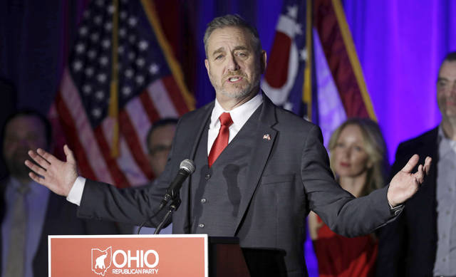 FILE - In this Nov. 6, 2018 file photo, Ohio Attorney General Dave Yost speaks at the Ohio Republican Party event, in Columbus, Ohio. Yost's attempt to block Ohio's nuclear plants from collecting fees on electricity bills that were authorized by a law at the center of a $60 million federal bribery probe was denied by a county judge Friday, Oct. 2, 2020. (AP Photo/Tony Dejak, File)
